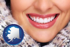 alaska map icon and beautiful white teeth forming a beautiful smile