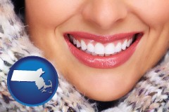 massachusetts map icon and beautiful white teeth forming a beautiful smile