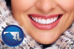 maryland map icon and beautiful white teeth forming a beautiful smile