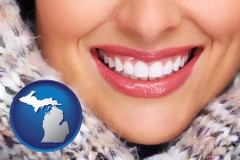 michigan map icon and beautiful white teeth forming a beautiful smile