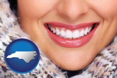 north-carolina map icon and beautiful white teeth forming a beautiful smile