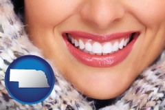 nebraska map icon and beautiful white teeth forming a beautiful smile