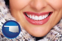 oklahoma map icon and beautiful white teeth forming a beautiful smile
