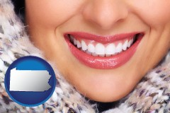 pennsylvania map icon and beautiful white teeth forming a beautiful smile