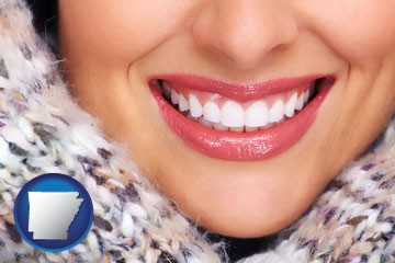 beautiful white teeth forming a beautiful smile - with Arkansas icon