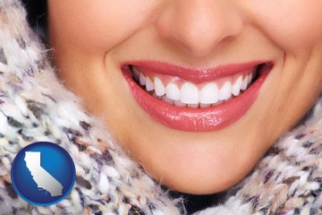 beautiful white teeth forming a beautiful smile - with California icon