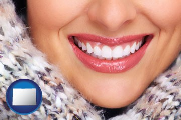 beautiful white teeth forming a beautiful smile - with Colorado icon