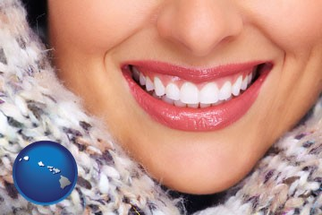 beautiful white teeth forming a beautiful smile - with Hawaii icon