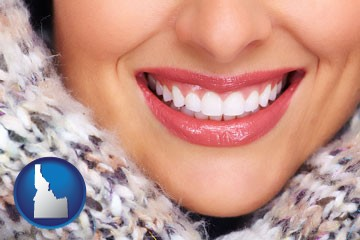 beautiful white teeth forming a beautiful smile - with Idaho icon