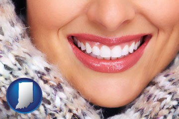beautiful white teeth forming a beautiful smile - with Indiana icon