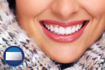 beautiful white teeth forming a beautiful smile - with Kansas icon