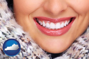 beautiful white teeth forming a beautiful smile - with Kentucky icon