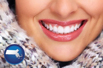 beautiful white teeth forming a beautiful smile - with Massachusetts icon
