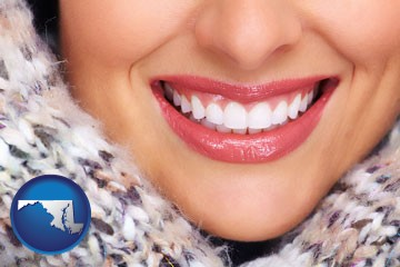beautiful white teeth forming a beautiful smile - with Maryland icon