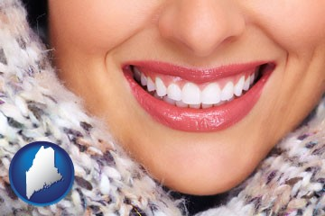 beautiful white teeth forming a beautiful smile - with Maine icon
