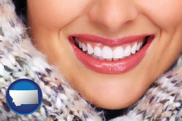 beautiful white teeth forming a beautiful smile - with Montana icon