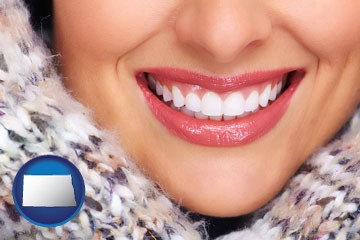 beautiful white teeth forming a beautiful smile - with North Dakota icon