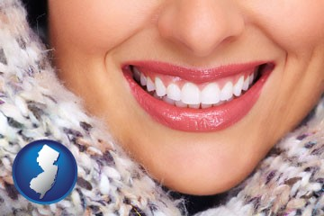 beautiful white teeth forming a beautiful smile - with New Jersey icon