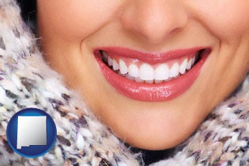 beautiful white teeth forming a beautiful smile - with New Mexico icon