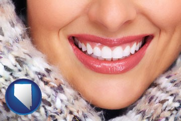 beautiful white teeth forming a beautiful smile - with Nevada icon