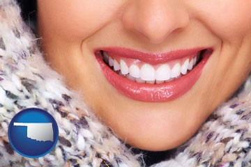 beautiful white teeth forming a beautiful smile - with Oklahoma icon