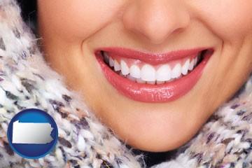 beautiful white teeth forming a beautiful smile - with Pennsylvania icon