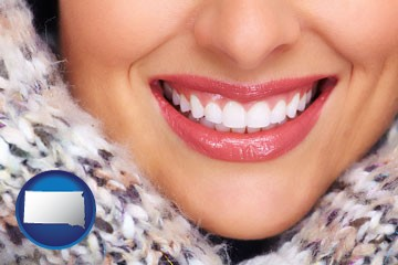 beautiful white teeth forming a beautiful smile - with South Dakota icon