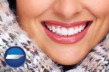 beautiful white teeth forming a beautiful smile - with Tennessee icon