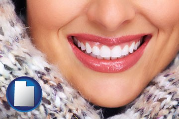 beautiful white teeth forming a beautiful smile - with Utah icon