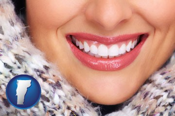 beautiful white teeth forming a beautiful smile - with Vermont icon